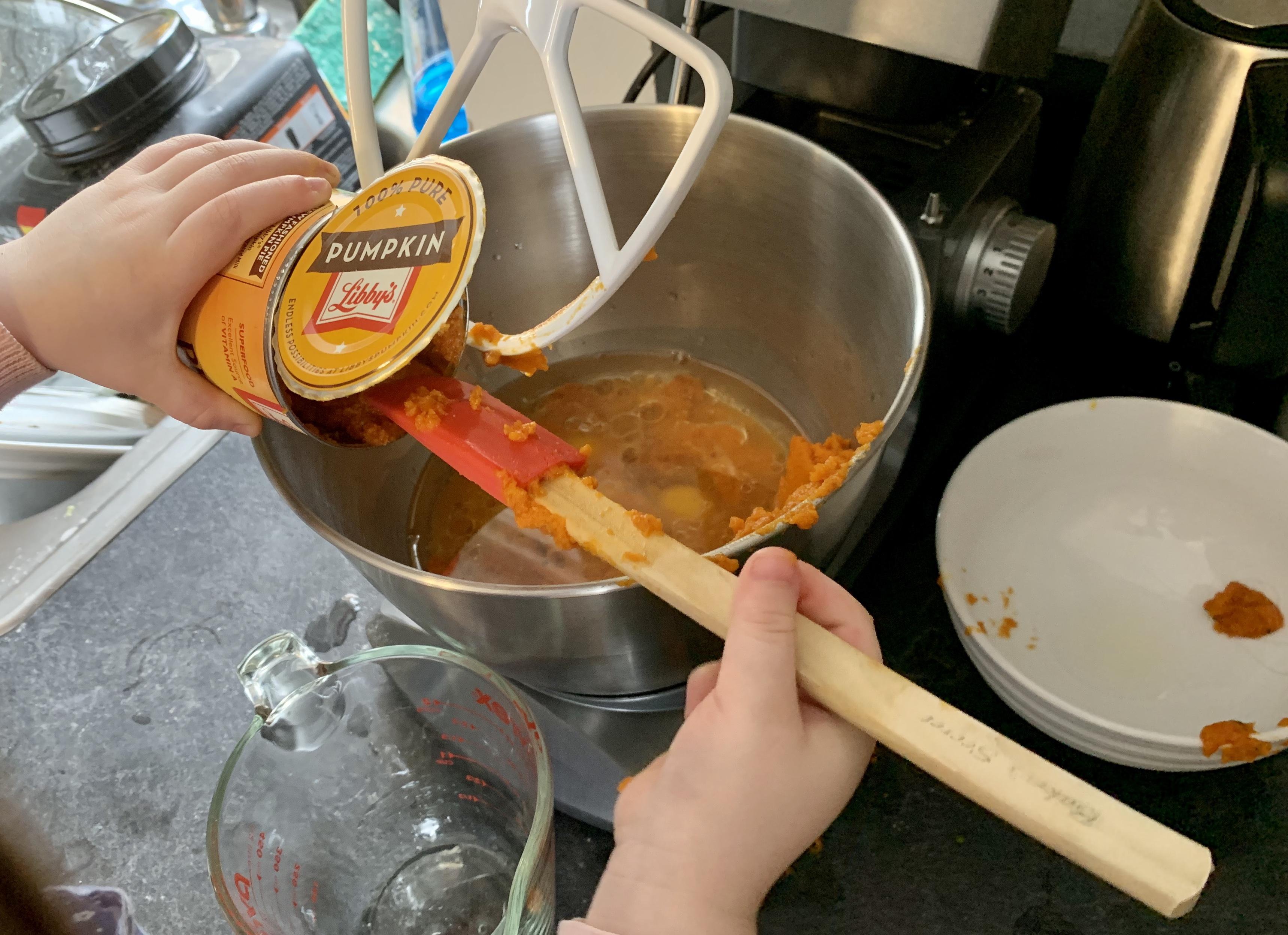 Scraping pumpkin into the bowl