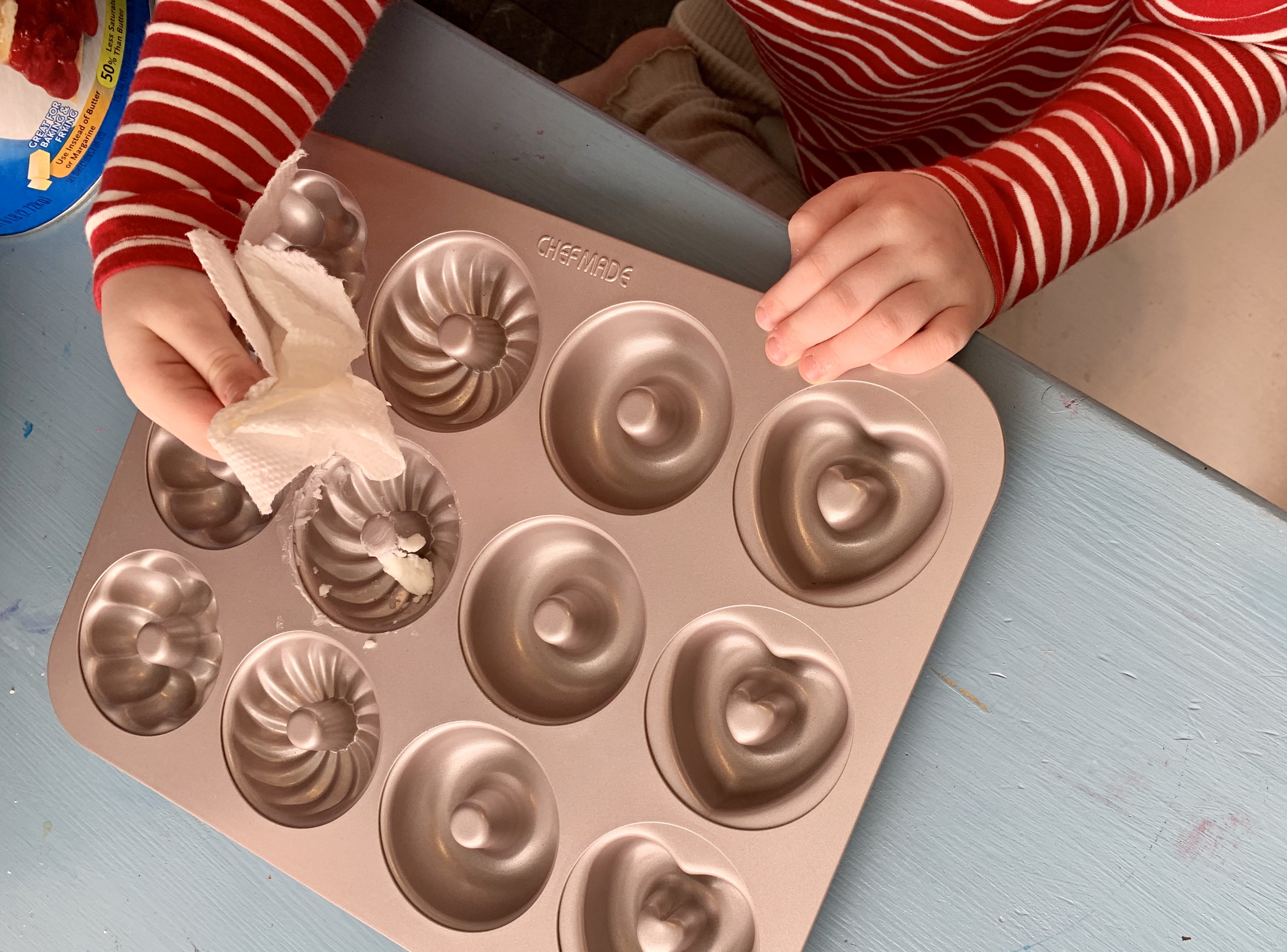 Greasing the doughnut pan