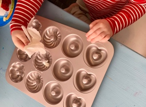 Greasing the doughnut pan