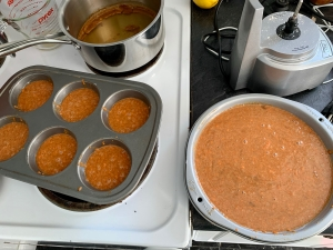 Unbaked carrot cake and cupcakes, with background boiled cider.