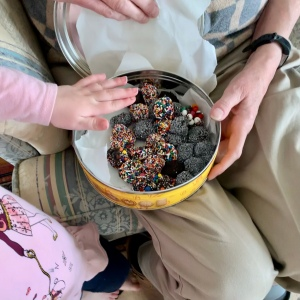 Sharing a tin of brigadeiros with Grammie